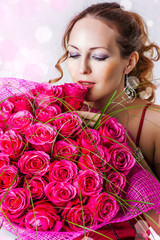 woman with bouquet of pink roses