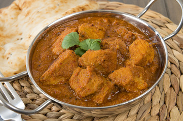 Goan Pork Vindaloo - Indian pork curry with naan bread