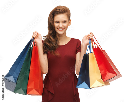 teenage girl in red dress with shopping bags