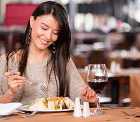 Woman eating at a restaurant