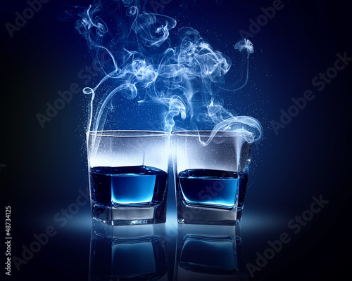Two glasses of blue cocktail