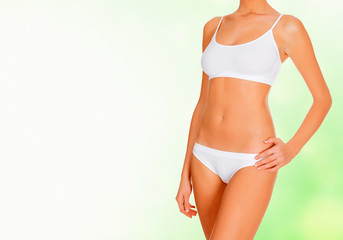 Female body against abstract green background
