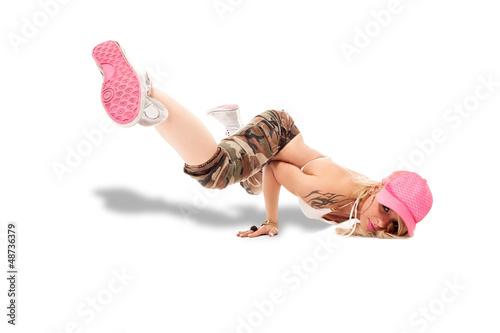Female Break dancer performing freeze