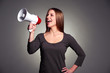 happy woman with loudspeaker