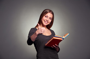 attractive young woman showing thumbs up
