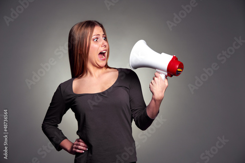 frightened woman looking on megaphone