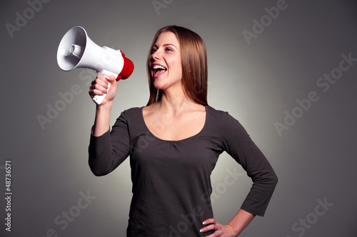 happy woman with loudspeaker
