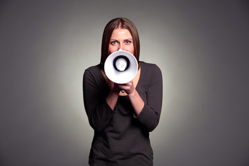 young woman holding loudspeaker
