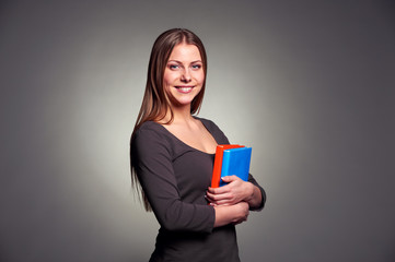 young woman holding two books