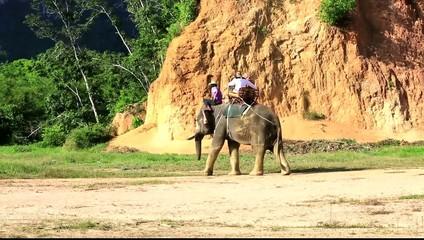 Tourists riding elephant in Krabi, Thailand