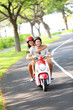 Scooter - couple driving in summer