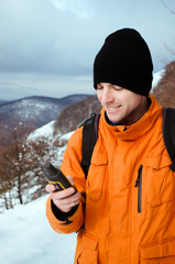 Backpacker looking at GPS