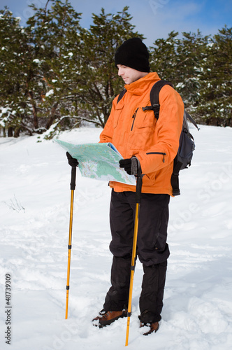 Hiker looking at map