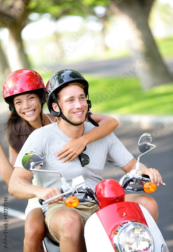 Free young couple on scooter on summer vacation