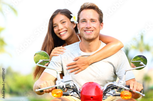 Happy young couple in love on scooter