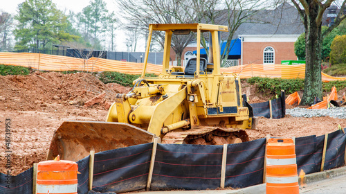 Yellow Bulldozer on Dirt Site