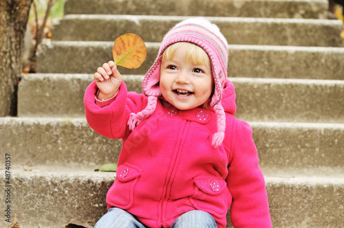 toddler with leaf