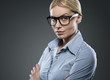 Portrait of young attractive businesswoman wearing glasses