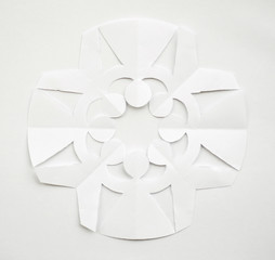PAPER SNOWFLAKE CUT AS RUSSIAN PEOPLE HOLDING THEIR HANDS