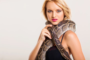 attractive young fashion woman with python
