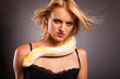 cool fashion model with python on her shoulder