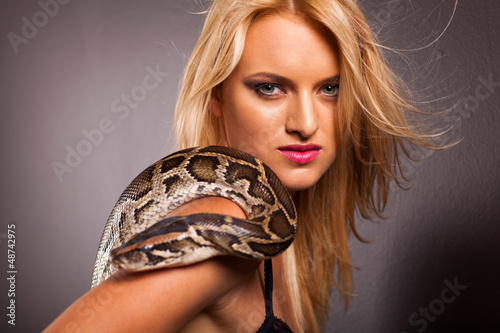 attractive young woman with python on her shoulder