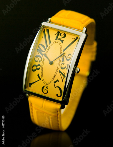 Beautiful luxury woman wristwatch in yellow color