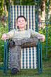 Boy is resting in a deckchair