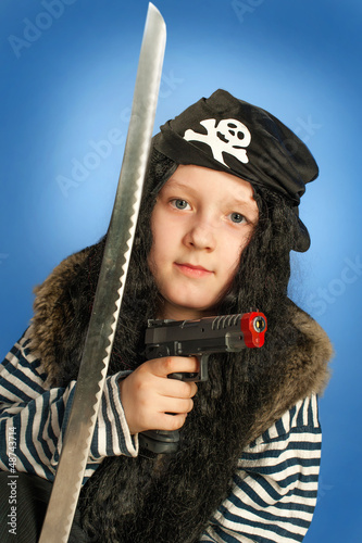 Pirate boy with gun and sword. Halloween finery.