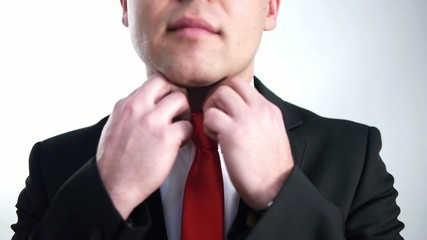 businessman sats his red tie