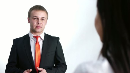businessman talking with businesswoman
