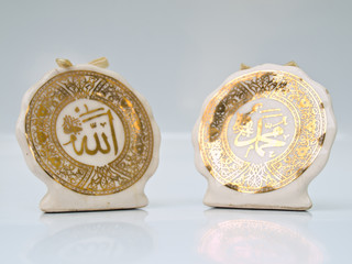 Ceramic signs of Allah and Muhammad in golden Arabic caligraphy