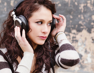 Attractive young woman listening to music