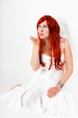 Red-haired woman as an angel