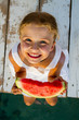 Summer joy, girl eating fresh watermelon on the beach