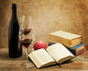relaxing moments with novel books and pair of wine glass