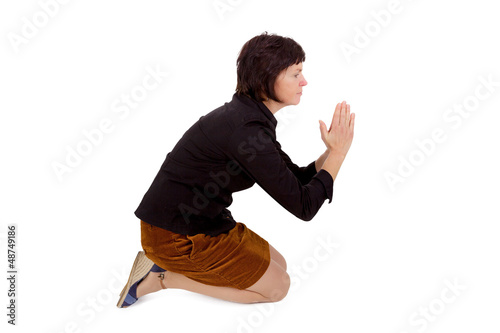 Woman kneeling and praying