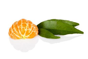 Half of mandarine tangerine with leaves on white