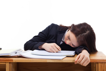 Young Asian woman sleeping on the desk.
