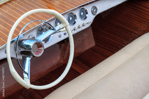Luxury wooden motor boat - steering wheel and leather seats