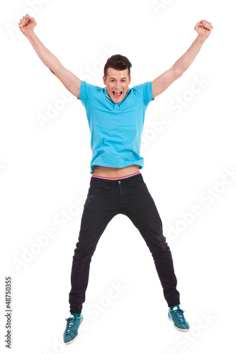 casual man jumping in air