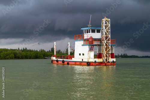 Ferry on the river before storm in Koh Kho Khao, Thailand