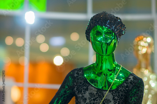 Modern fashion dressed  mannequins with color metall glossy surf