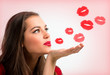 Portrait of a beautiful woman blowing  red kisses