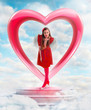 Beautiful angel woman sending love from the heart shaped gate