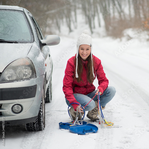 Woman applying Snow Chains