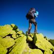 Hiker walking in autumn mountains