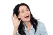 Smiling pretty woman eavesdropping