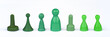 GREEN MONOPOLY FIGURES ON WHITE BACKGROUND