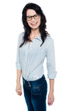 Happy woman in trendy wear. Shirt and jeans